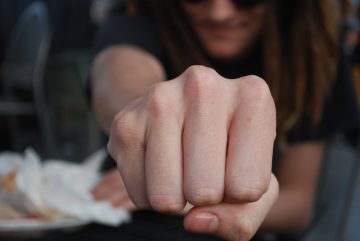 Fist Bump - Handshakes to Avoid at Events